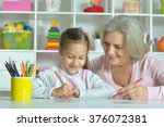 grandmother with granddaughter... | Shutterstock . vector #376072381