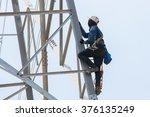 worker climbing on transmission ...   Shutterstock . vector #376135249