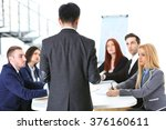 young businessman standing back ... | Shutterstock . vector #376160611