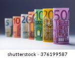 Several hundred rolls of euro banknotes in different positions. - stock photo
