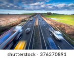 fast moving vehicles on busy... | Shutterstock . vector #376270891