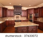 Stock photo luxury home kitchen front with center island and cabinets 37633072