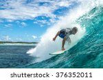 a surfer rides in the big ocean ... | Shutterstock . vector #376352011