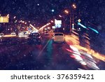 City Lights On Winter Road ...