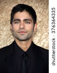 """Small photo of Adrian Grenier at the Season 7 Premiere of """"Entourage"""" held at the Paramount Pictures Studios in Hollywood, USA on June 16, 2010."""