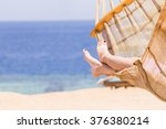 young woman resting in hammock... | Shutterstock . vector #376380214