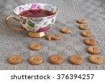 cup of tea witn round crackers... | Shutterstock . vector #376394257