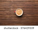 cup of coffee on wooden table ... | Shutterstock . vector #376429339