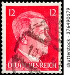Small photo of DZERZHINSK, RUSSIA - JANUARY 18, 2016: A postage stamp of GERMANY shows portrait of Adolf Hitler, circa 1941