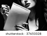 Woman writing a note - stock photo