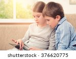 children playing with tablet pc | Shutterstock . vector #376620775