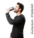 young man drinking beer | Shutterstock . vector #376686469