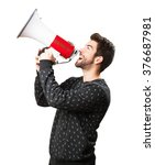 Young Man Holding A Megaphone