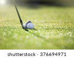 golfer hitting iron club on... | Shutterstock . vector #376694971
