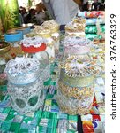 Small photo of NAKHONSAWAN/THAILAND-JANUARY 30, 2016: Used bottles decorated with various lace cloth for enhancing the cost, activity in the public park. This is for sale and using in mercy donation.