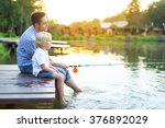 dad and son fishing on lake | Shutterstock . vector #376892029