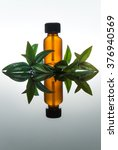Small photo of Myrtle essential oil with amber glass bottle, vertical with reflection