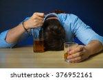 drunk man drinking alcohol at... | Shutterstock . vector #376952161