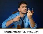 drunk man drinking alcohol at... | Shutterstock . vector #376952224