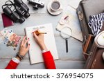 woman making list for traveling  | Shutterstock . vector #376954075