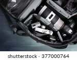 Photographer's equipment on a dark blue background - stock photo