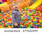 child  colored balls  the game | Shutterstock . vector #377032399
