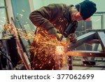 electric grinder. a man working ... | Shutterstock . vector #377062699