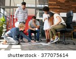 creative people looking at... | Shutterstock . vector #377075614