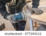 carpenter using electric sander.... | Shutterstock . vector #377104111