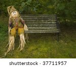 Scarecrow On A Park Bench.