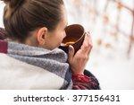 Girl In Rug Drinks Hot Tea In...