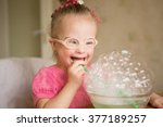 girl with down syndrome makes... | Shutterstock . vector #377189257