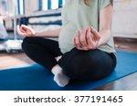 pregnant woman doing yoga | Shutterstock . vector #377191465