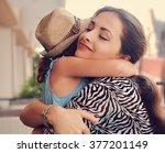 happy mother hugging her... | Shutterstock . vector #377201149