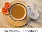 a cup of coffee with gingerbread | Shutterstock . vector #377208904
