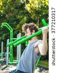 Active Young Man Exercising On...