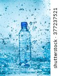 bottle of water splash on a... | Shutterstock . vector #377237521