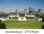 London's National Maritime Museum and skyscraper of Canary Wharf. - stock photo