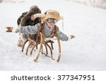 two boys sledding with mountain ...   Shutterstock . vector #377347951