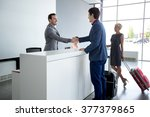 Man And Receptionist Handshake...