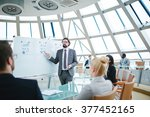 explaining data to colleagues | Shutterstock . vector #377452165
