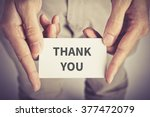 """ thank you "" word on card hold ... 
