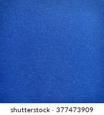 Small photo of Cold dark cobalt dye color bumpy latex of air-filled polyurethane synthetic floor carpet textile fond design. Detail close-up view with space for text on clean glow blank bubble dust crushed design
