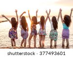 happy girls at sunset | Shutterstock . vector #377493601