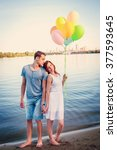 beautiful happy couple with... | Shutterstock . vector #377593645