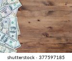 pile of us dollar bills on old ... | Shutterstock . vector #377597185