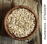 oat flakes in a round bowl on... | Shutterstock . vector #377632639