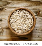 oat flakes in a round bowl on... | Shutterstock . vector #377651065