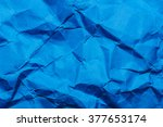 blue crumpled paper background. | Shutterstock . vector #377653174