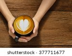 Woman Holding Cup Of Coffee...